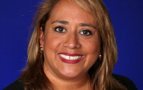 Dr. Diana Caris Biography