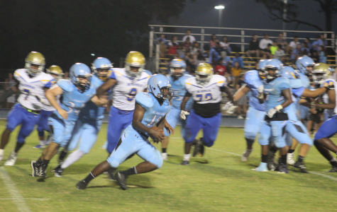 Pope John Paul Running Back going for the first down against Cardinal Newman.