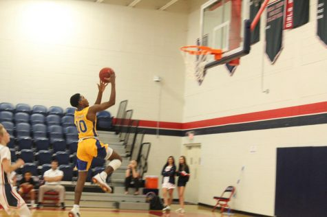 Sophomore Jordan Johnson goes for a lay up against Oxbridge Academy during a regular season game.