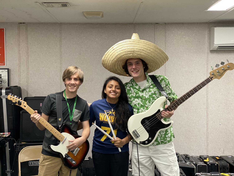 Michael Anzivino, Padraig Mee, and Amy Guzman attend Rock Band practice.